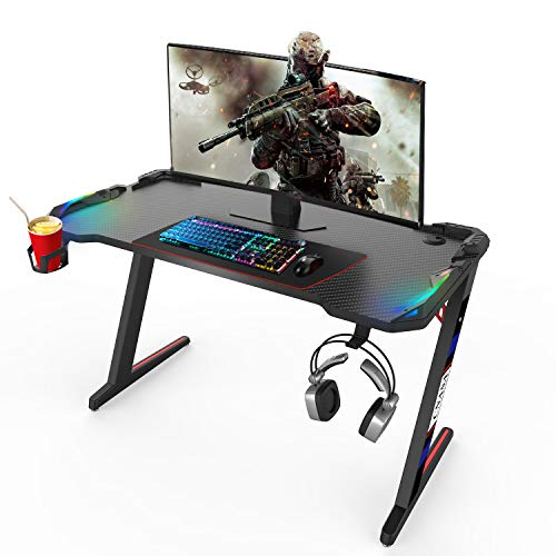 CNASA Gaming Desk,Top class Dwelling Location of enterprise PC Pc Desk for Gamer Pro, Sunless Gaming Desks Workstation with RGB LED Lights,Cup Holder, Headphone Hook,Storage and a pair of Cable Management Holes